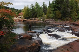 Wildlife technician, Pierre-Étienne Vachon finds solace by Onaping Falls. Photo credit: Catherine Lau.