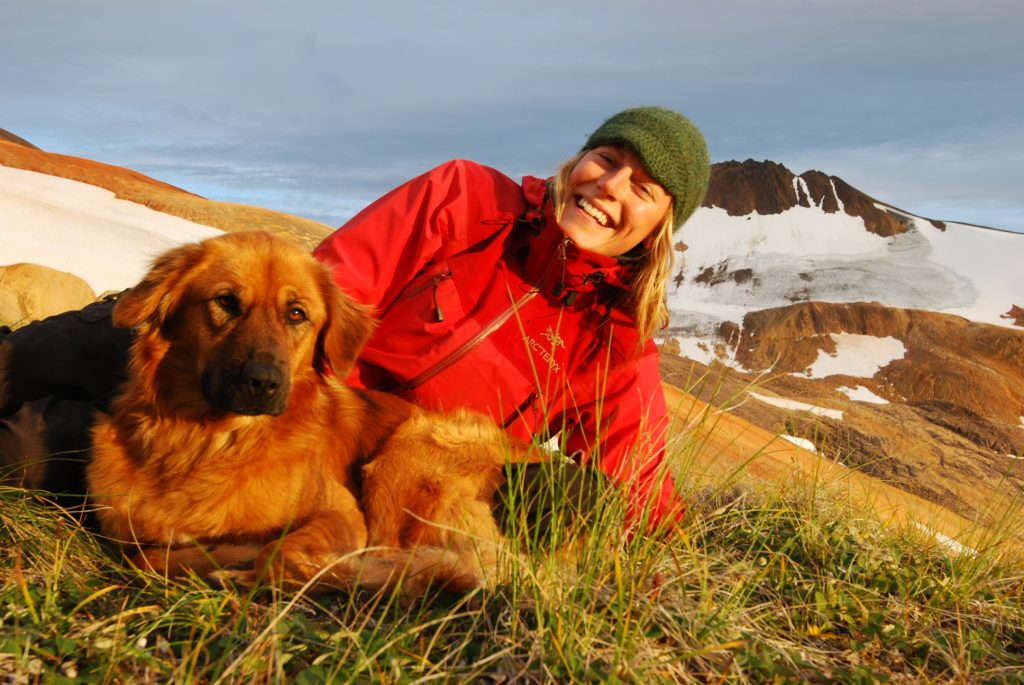 Kira Hoffman taking in the sunset with her sidekick Dusty in Edziza Provincial Park.