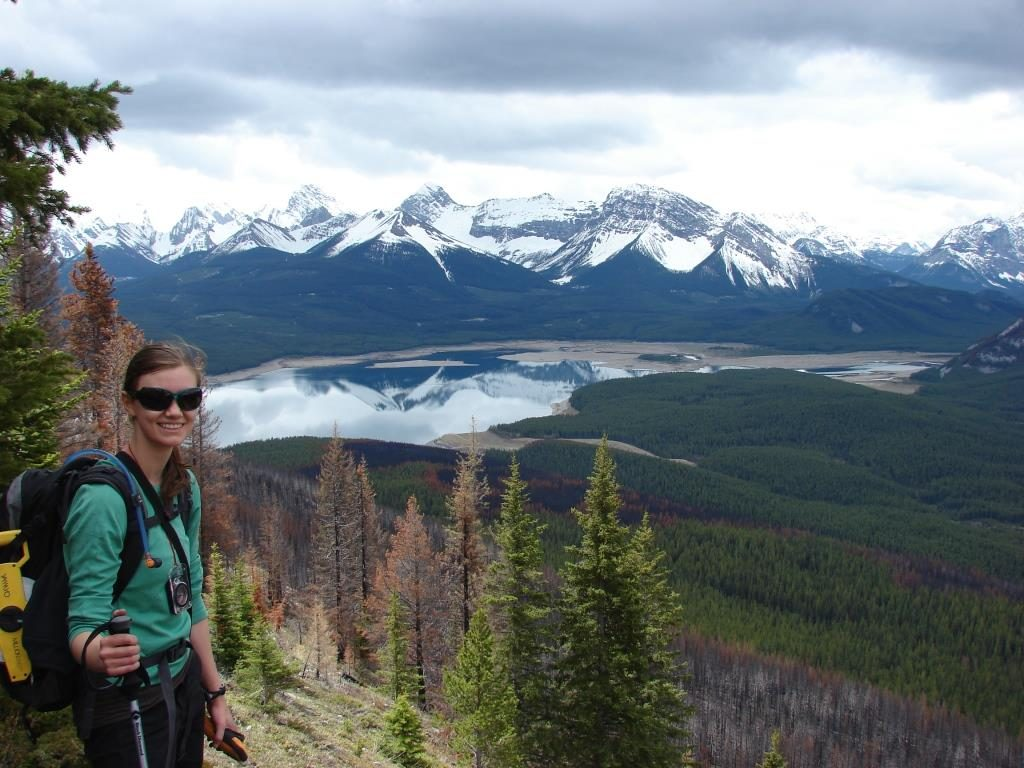 Crisia by one of her mountain pine beetle research field sites, overlooking the Mt. Nestor burn in Spray Valley Provincial Park.